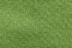 Textured background rough fabric of green olive color.  Stock Photo