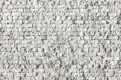 Textured Background of Rough Stucco-Covered Cream Brick Wall Stock Photography