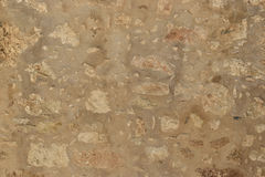 Textured background of stone wall. Greece Royalty Free Stock Photos
