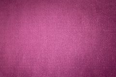 Textured background surface of textile upholstery furniture close-up. magenta red Color fabric structure.  royalty free stock photo
