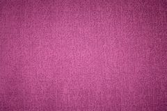 Textured background surface of textile upholstery furniture close-up. magenta red Color fabric structure.  royalty free stock photography