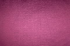Textured background surface of textile upholstery furniture close-up. magenta red Color fabric structure.  royalty free stock photos