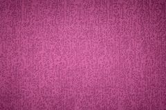 Textured background surface of textile upholstery furniture close-up. magenta red Color fabric structure.  stock images