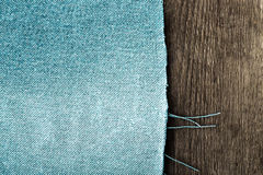 Textured background of two materials - half is blue jeans  Royalty Free Stock Photography