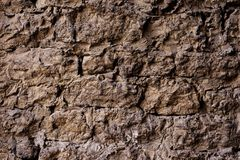Textured background of a wall of medieval stone masonry. The wall is sloppy built of mountain stones. Medieval style. Textured background of a wall of medieval Stock Photo