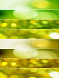 Textured banner backgrounds. Vertical composition divided in eight horizontal lines with abstract sparkling textures in yellow and green tones Stock Photo