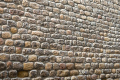 Textured biased ancient stone wall of a historical building Royalty Free Stock Photography