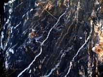 Textured black stone with streaks Royalty Free Stock Images