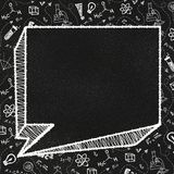 Textured blackboard with an Empty speech bubble and school themed doodles stock photos