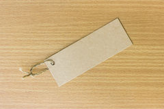 Textured blank tag tied with brown string. Price tag Stock Image