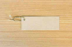 Textured blank tag tied with brown string. Price tag Stock Photos