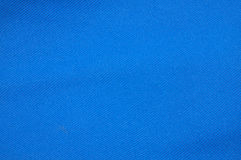 Textured blue fabric. Abstract background of textured blue fabric or material with copy space Stock Photos