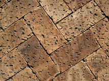 Textured brick pattern. Overhead view of textured brick paving pattern in diagonal shapes Royalty Free Stock Photos