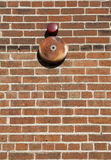 Textured brick wall background and alarm bell. Stock Images