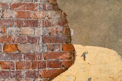 The textured brick wall with destroyed plaster Royalty Free Stock Images