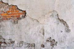 The textured brick wall with destroyed plaster Stock Photography