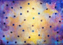 Blue and yellow background with stars. Textured bright colored blue and yellow background with foil stars decoration royalty free stock photos