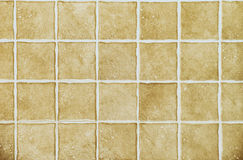 Textured brown square tiles Royalty Free Stock Photography