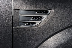 Textured car bodywork Stock Images