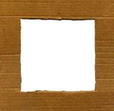 Textured cardboard frame with rough edges isolated Stock Images