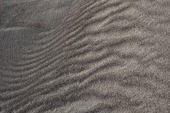 Textured Ciemnego Brown piaska diun tło obraz royalty free