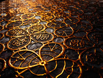 Textured cloth from patterns of gold color. Stock Photo