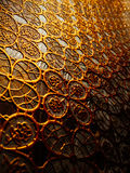 Textured cloth from patterns of gold color. Royalty Free Stock Photography