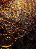 Textured cloth from patterns of gold color. Stock Photography