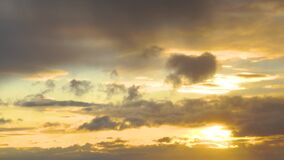 Textured clouds against the backdrop of a dramatic and glorious dawn. Dramatic skies in orange, exhilarating mood