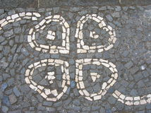 Textured cobblestone paving Stock Images