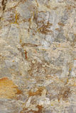 Textured and colored stone abstract background in warm tone Royalty Free Stock Image