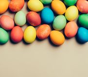 Textured colorful eggs laying on the beige background. Easter homemade decorations. Copyspace Stock Photography