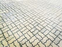 Textured of Concrete blocks on public footpath. Royalty Free Stock Photography