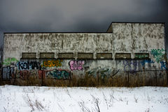 Textured concrete building in winter. A creepy old textured concrete building covered in graffitis in winter Royalty Free Stock Images