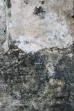 Textured concrete wall. Abstract background of old discolored urban concrete wall stock illustration