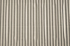 Textured corrugated striped cardboard with natural fiber parts Royalty Free Stock Images