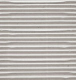 Textured corrugated striped cardboard with natural fiber parts Stock Image