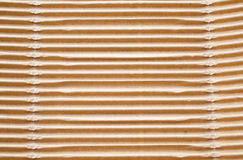 Textured corrugated striped cardboard with natural fiber parts Stock Photography