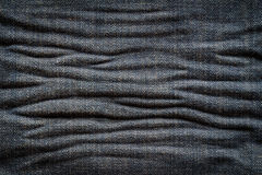 Textured creased denim striped jeans Stock Photo