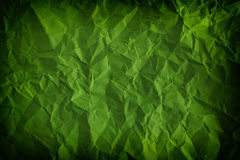 Textured, crumpled green background Stock Images