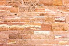 Textured czerwony kamiennej ściany tło Zdjęcie Royalty Free