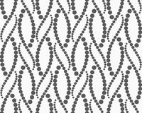 Textured with dots wavy snakes Stock Images