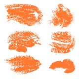 Textured dry brush strokes of orange paint Royalty Free Stock Photography