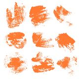 Textured dry brush strokes of orange paint Stock Photography