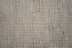 Textured fabric background.Structure of gray fabric. Shaving. Creative vintage background. stock photo
