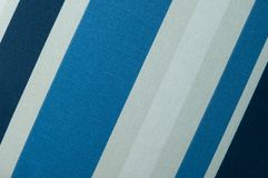 Textured fabric with a pattern of diagonal strips. Of white and shades of blue Stock Images