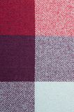 Textured fabric with a pattern of squares of shades. Of red and purple Royalty Free Stock Image