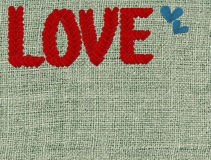 Textured fabric with stitched hearts Royalty Free Stock Photos
