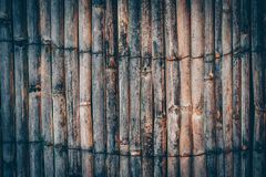 Textured fence made of thin wooden sticks aged and weathered. Na. Tural background of wooden rails in a vertical row stock photos