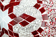 Textured fragment of stained glass with a geometric red-and-white pattern. Royalty Free Stock Photo